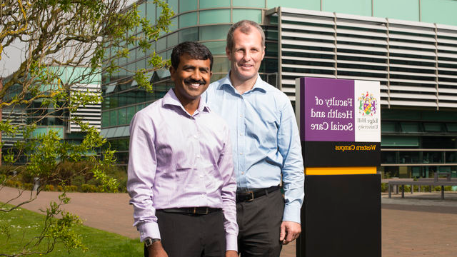 Dr Murali Kirshna and Steve Jones outside the Faculty of Health and Social Care